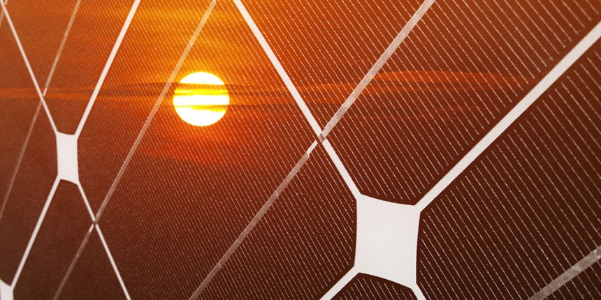 Solar panel and red sun